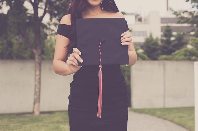 Girl holding a graduation cap